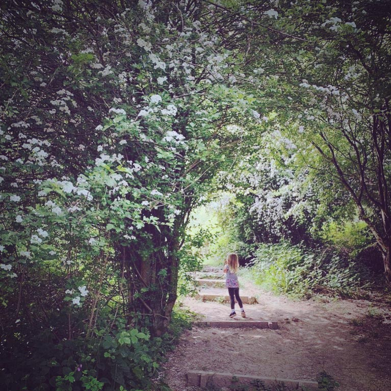 girl in wooded glade